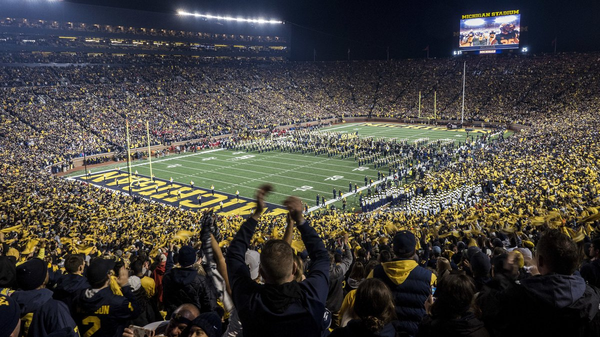 In this Oct. 13, 2018, file photo, fans cheer as the Michigan team takes the field at Michigan...