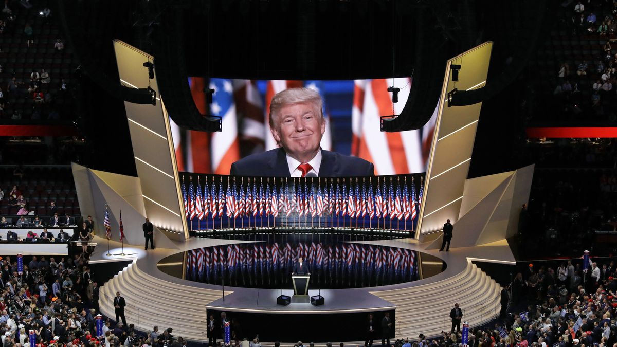 In this July 21, 2016, file photo Republican presidential candidate Donald Trump smiles as he addresses delegates during the final day session of the Republican National Convention in Cleveland. After months of insisting that the Republican National Convention go off as scheduled despite the coronavirus pandemic, Trump is slowly coming to accept that the event will not be the four-night informercial for his re-election that he had anticipated.
