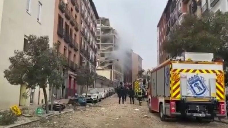 In this image made from video provided by Emergencias Madrid, firefighters attend the scene...