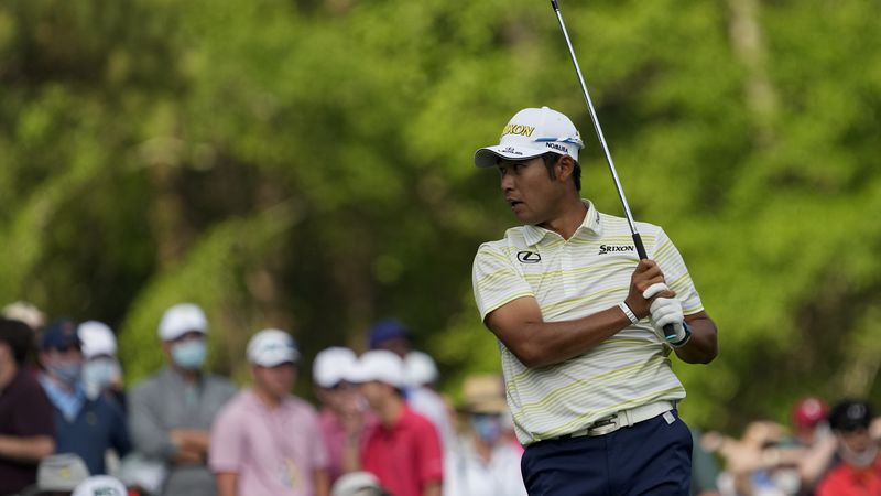 Hideki Matsuyama, of Japan, reacts to his tee shot on the 12th hole during the final round of...