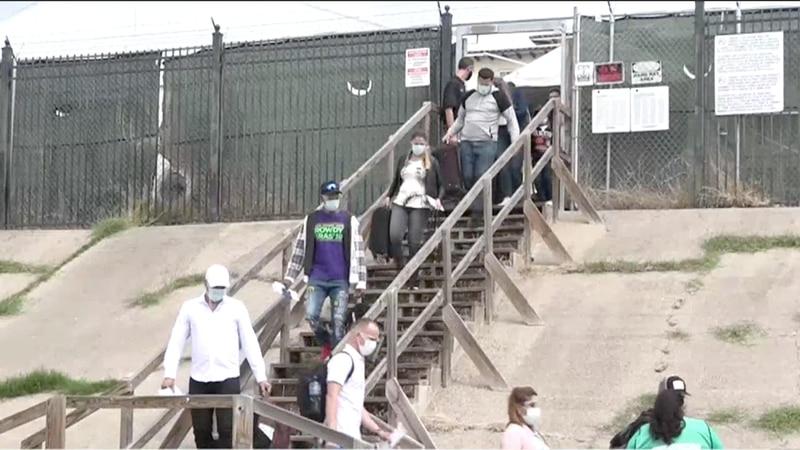 Dozens of asylum seekers pass through Laredo
