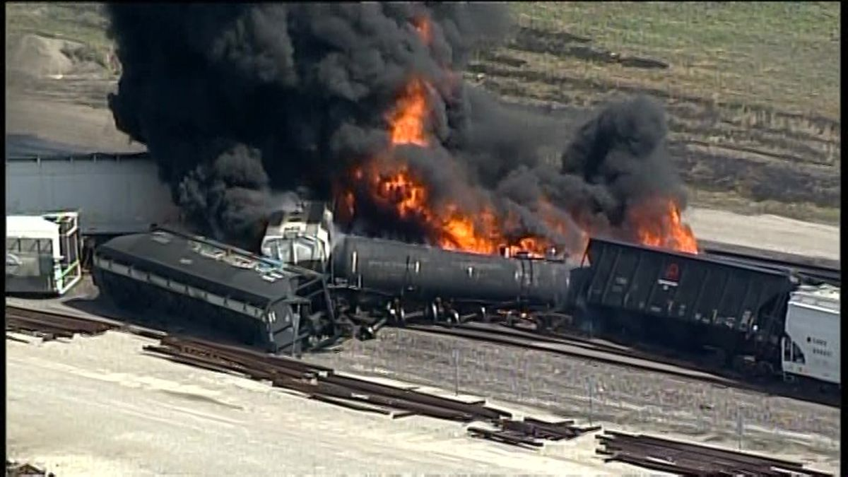 A freight train bearing a flammable liquid used in solvents derailed in an Illinois suburb of...
