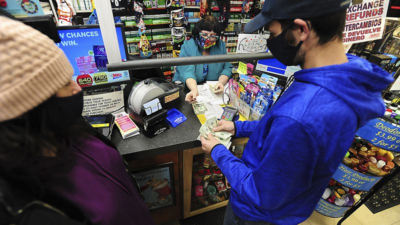 Michael and Amanda Lazovich of Plain, Pa., purchase Powerball and Mega Millions lottery tickets...