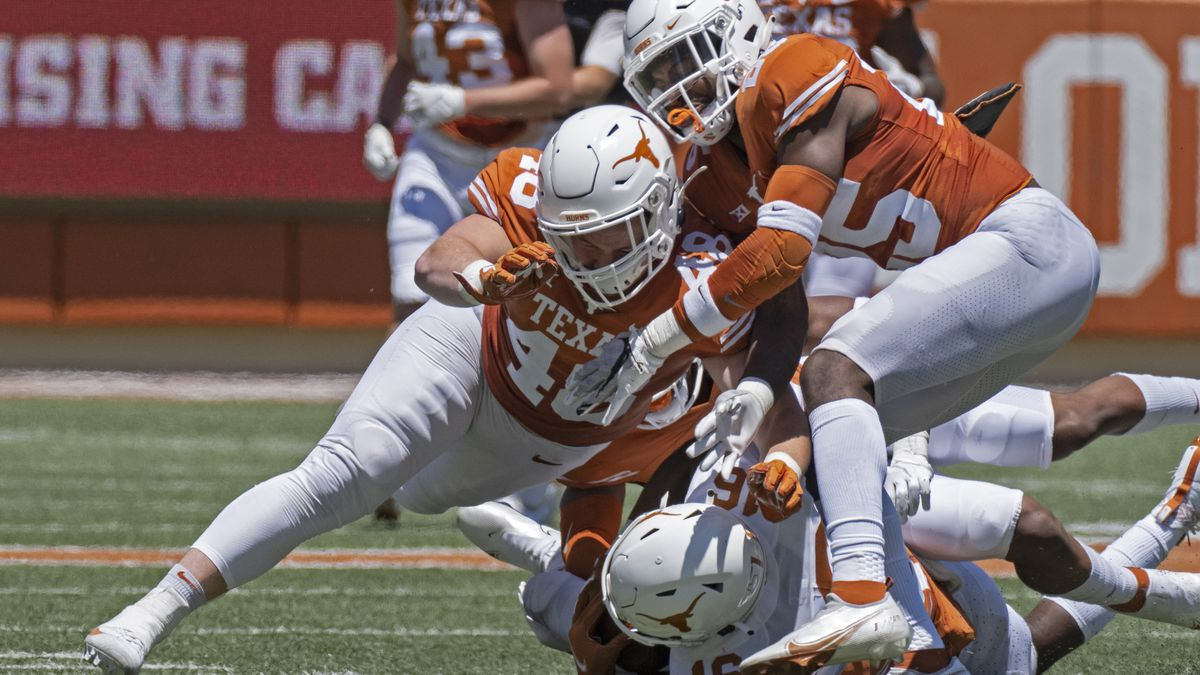 FILE - In this April 24, 2021, file photo, Texas defenders Jake Ehlinger, left, and B.J....