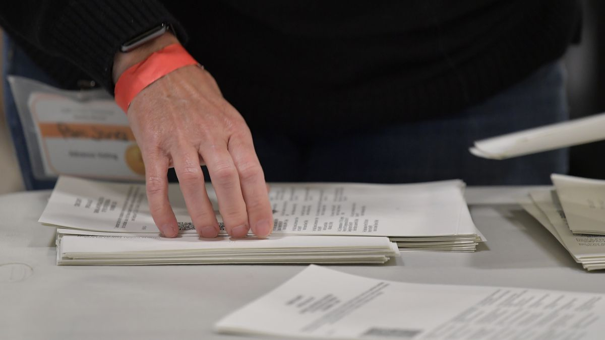 Cobb County Election officials handle ballots during an audit, Monday, Nov. 16, 2020, in...