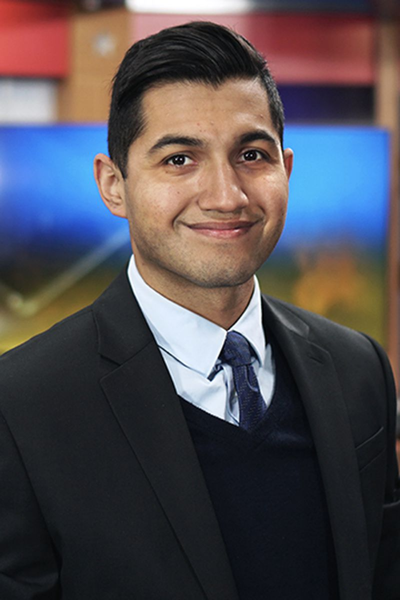 Headshot of Justin Reyes, Web Producer/ Reporter