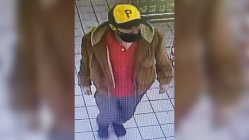 Authorities searching for man accused of robbery