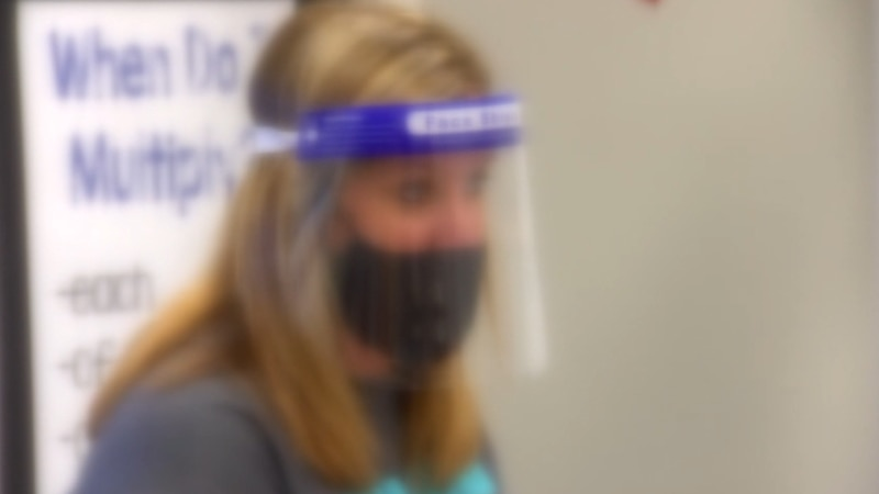 UISD staff wearing mask and face shield