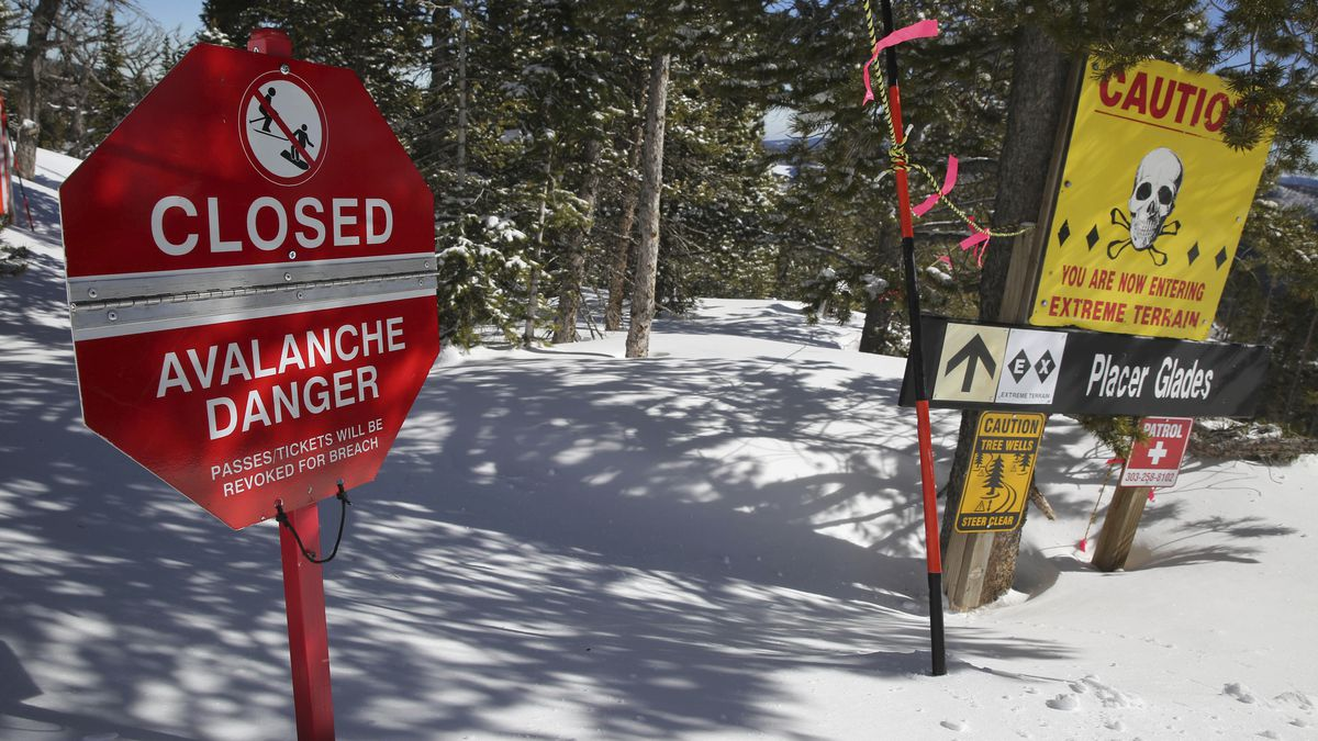 FILE- In this Feb. 26, 2014, file photo, a sign alerts skiers to danger on Corona Bowl, known...
