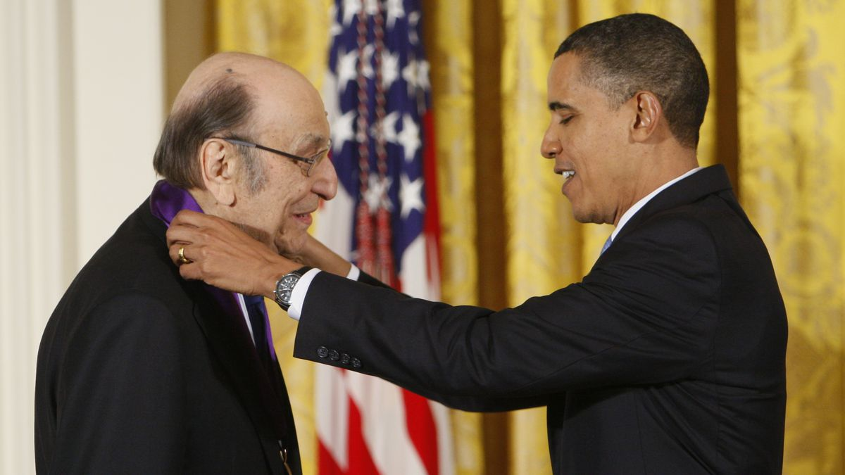 "In this Thursday, Feb. 25, 2010, file photo, President Barack Obama presents a 2009 National Medal of Arts to Milton Glaser, in the East Room of the White House in Washington. Glaser, the designer who created the ""I (HEART) NY"" logo and the famous Bob Dylan poster with psychedelic hair, died Friday, June 26, 2020, his 91st birthday."