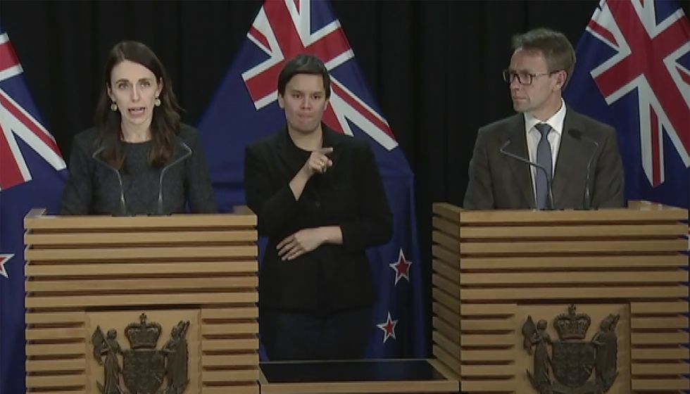In this image from a video, New Zealand Prime Minister Jacinda Ardern, left, and Director-General of Health Ashley Bloomfield, right, attend a news conference in Wellington, New Zealand on Tuesday, Aug. 11, 2020. Ardern says authorities have found four cases of the coronavirus in one Auckland household from an unknown source, the first cases of local transmission in the country in 102 days.