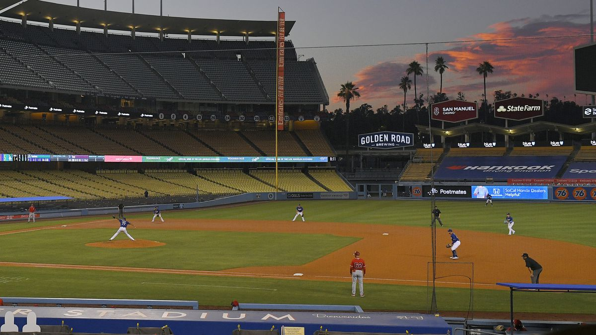 The Los Angeles Dodgers play the Los Angeles Angels at sunset during the fifth inning of a...