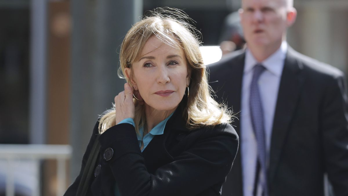 Actress Felicity Huffman arrives at federal court in Boston on Wednesday, April 3, 2019, to...