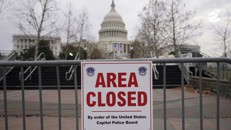 FILE - In this Monday, Jan. 11, 2021, file photo, signs are posted to close the area around the...